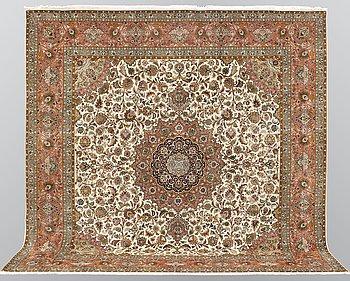 A carpet, Tabriz part silk so called 50 Radj, ca 300 x 302 cm.
