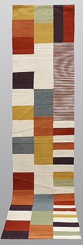 A runner, flat weave, ca 344 x 77 cm.