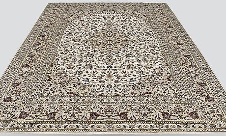 A carpet, kashan, ca 385 x 245 cm.