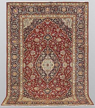 A carpet, Kashan, signed, ca 300 x 204 cm.