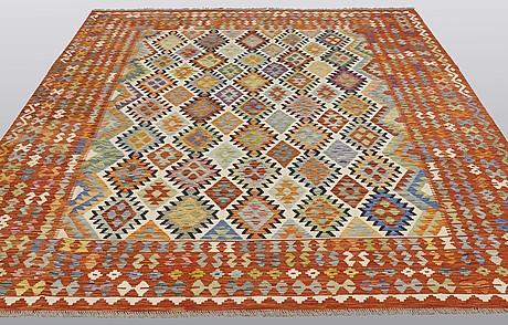 A carpet, kilim, ca 294 x 252 cm.