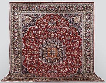 A carpet, Mashad, signed, ca 395 x 353 cm.