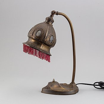 An Art Nouveau metal table lamp, early 20th century.
