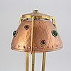 An early 20th century, brass and copper table lamp.