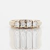 A 14k gold set with round brilliant-cut diamonds.