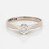 An 18k white gold set with a round brilliant-cut diamond.