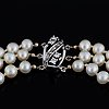 Three strand cultured pearl necklace, clasp with diamonds.