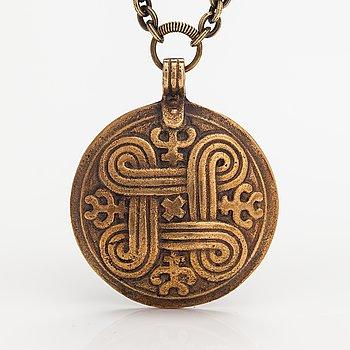 """A bronze necklace """"St. John's arms"""". Kalevala Koru, Helsinki."""