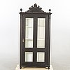 A display cabinet around 1900.