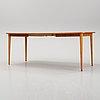A 1950's/60's teak dining table.
