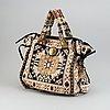 Gucci, a woven bag.
