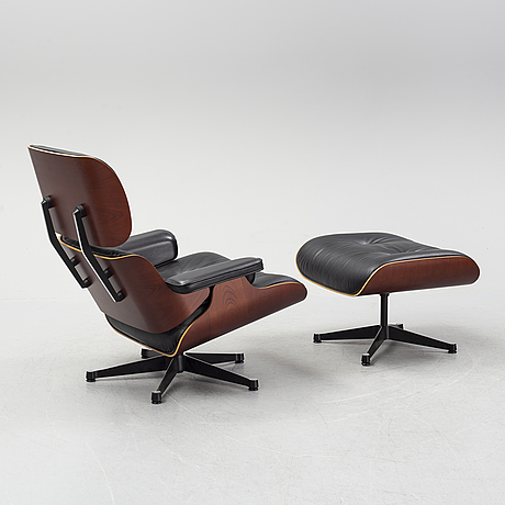 A 'lounge chair' with stool, charles and ray eames, for vitra, 2010's.