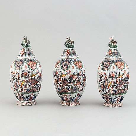 A five piece french faience garniture.