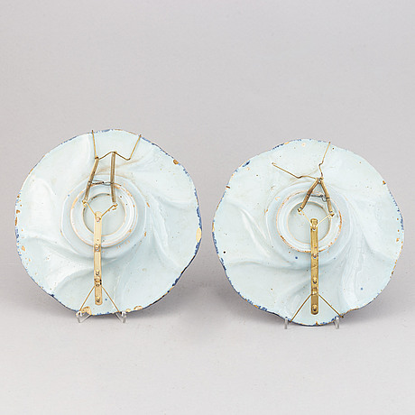 A pair of dutch faience buckel platte, 18th century.