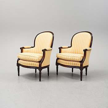 A pair of Louis XVI armchairs, second alf of the 20th Century.