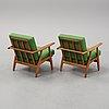 Hans j wegner, a pair of 'ge-240'/'cigarren' oak easy chairs, getama, denmark.