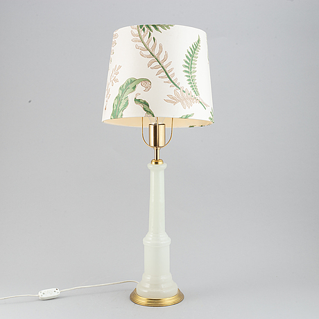 A brass and glass table lamp with lamp-shade. svenskt tenn, model no. 2583.