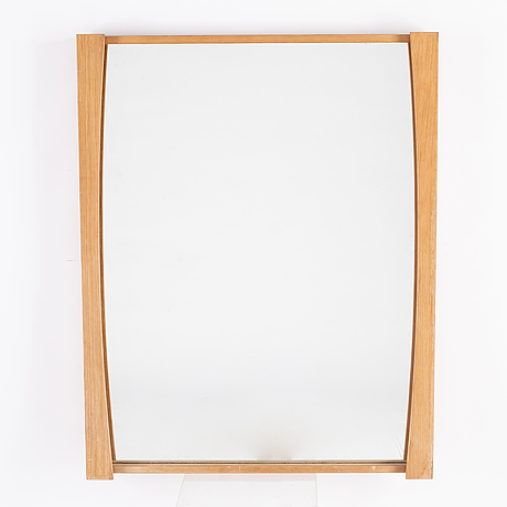 A 1970's pine mirror.