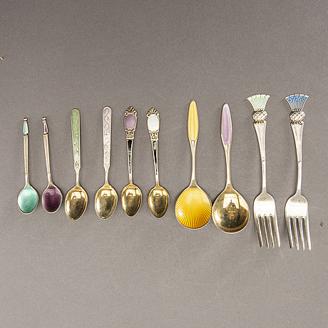 A 20th century set of 45 pcs of different silver and enamel cutlery total weight approx 432 gr.