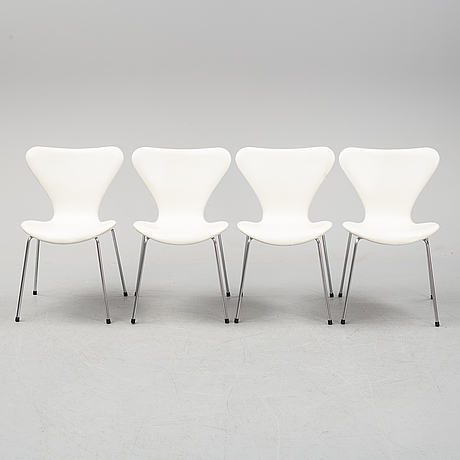 Four 'serie 7' chairs with leather upholstery by arne jacobsen for fritz hansen. designed 1955.
