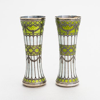 A pair of bud vases in parcel-gilt silver and guilloche enamel, early 20th century.