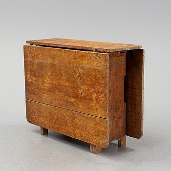 A pine gate leg table, 19th Century.