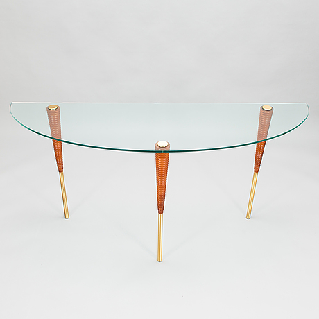 A set of three glass tables from 2000s.