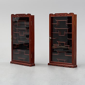 A pair of chinese wall cabinets, 20th century.