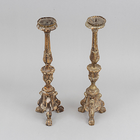 A pair of baroque style wooden candel holders, southern europe, 20th century.