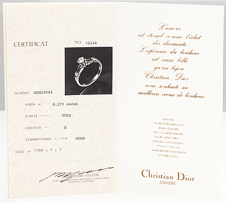 Dior, an 18k gold and platinum ring with a ca. 0.271 ct diamond. marked ch dior, 542.