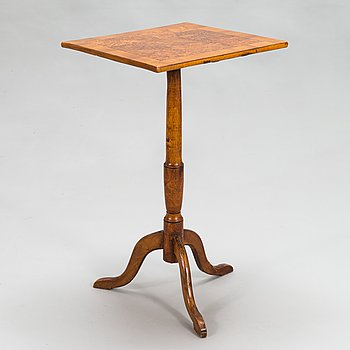 A tilt-top tripod table,  first half of the 19th century.