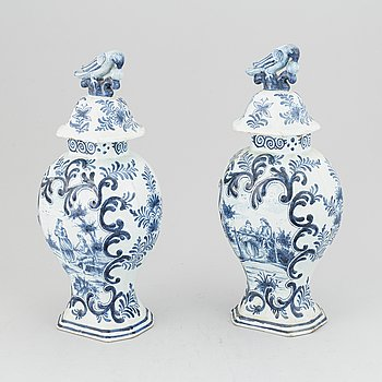 A pair of 19th century blue/white faience lidded jars, probably Dutch.