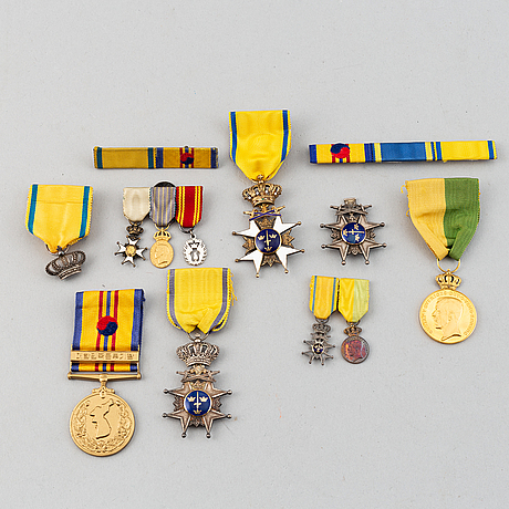 A set of medals and decorations, partly gold.