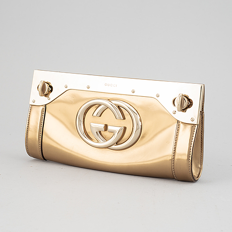 Gucci, 'starlight interlocking gg clutch'.