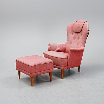 A 'Farmor' easy chair with stool by  Carl Malmsten, second half of the 20th Century.