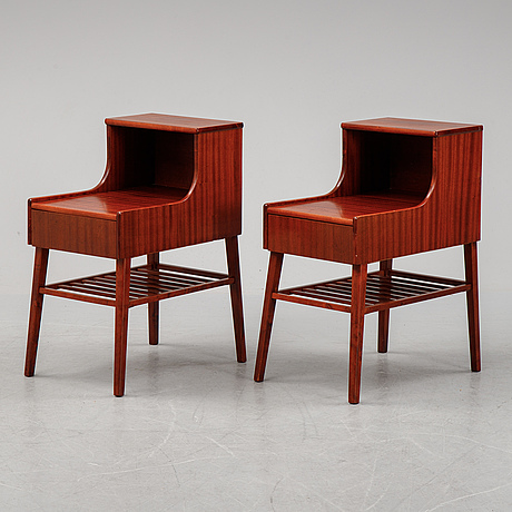 A pair of 20th century bedside tables.