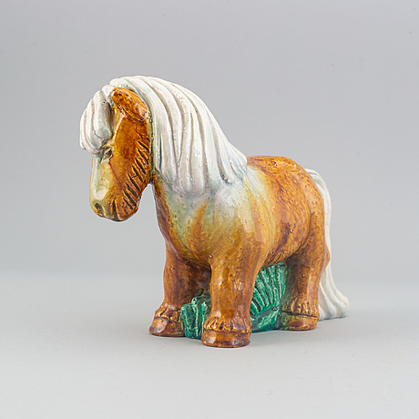 Gunnar nylund, a stoneware sculpture of a work horse for rörstrand signed.