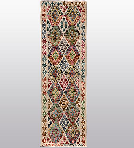 A runner, kilim, ca 249 x 67 cm.