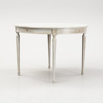 A Gustavian style dining table, mid 20th Century.