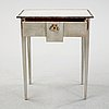 A painted table with a drawer, 19th century.