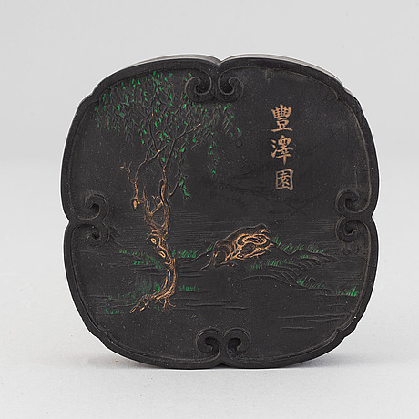 A chinese ink-cake, with calligraphy and decorated with an ox, 20th century.