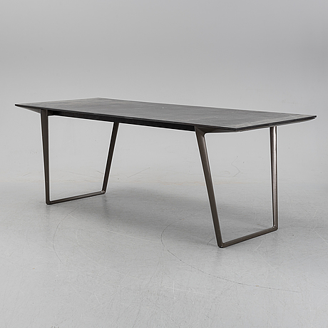 "Claudio bellini, a ""axy table"" from mdf italia, 21st century."