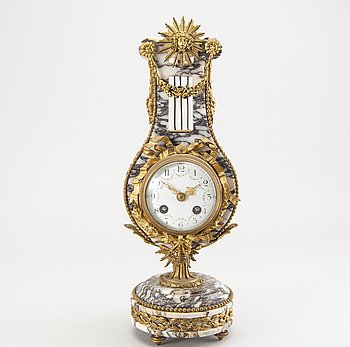 A Louis XVI-style table clock early 1900s.