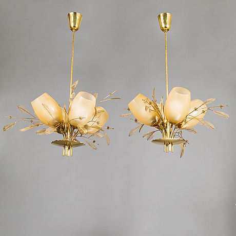 Paavo tynell, a pair of mid-20th-century '9029/4' chandeliers for taito, finland.