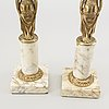 A pair of gustavian style candle sticks around 1900.