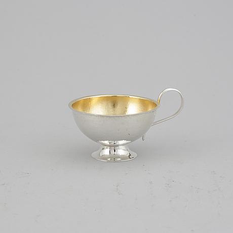 9+2 swedish parcel-gilt silver punsch cups, guldvaruhuset and svedboms, vetlanda, some 1964.