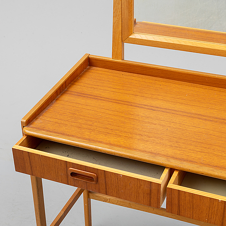 A teak make-up table from the second half of the 20th-century.