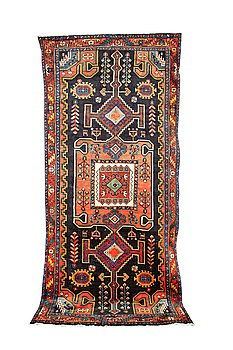 A carpet, Old Kurdistan, ca 325 x 152 cm.