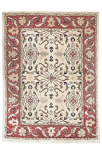 A rug, ziegler design, ca 231 x 176 cm.