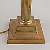 A pair of 20th century brass empire style table lamps.